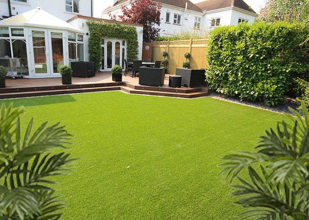 Artificial lawns carrick landscapes for Garden decking with artificial grass
